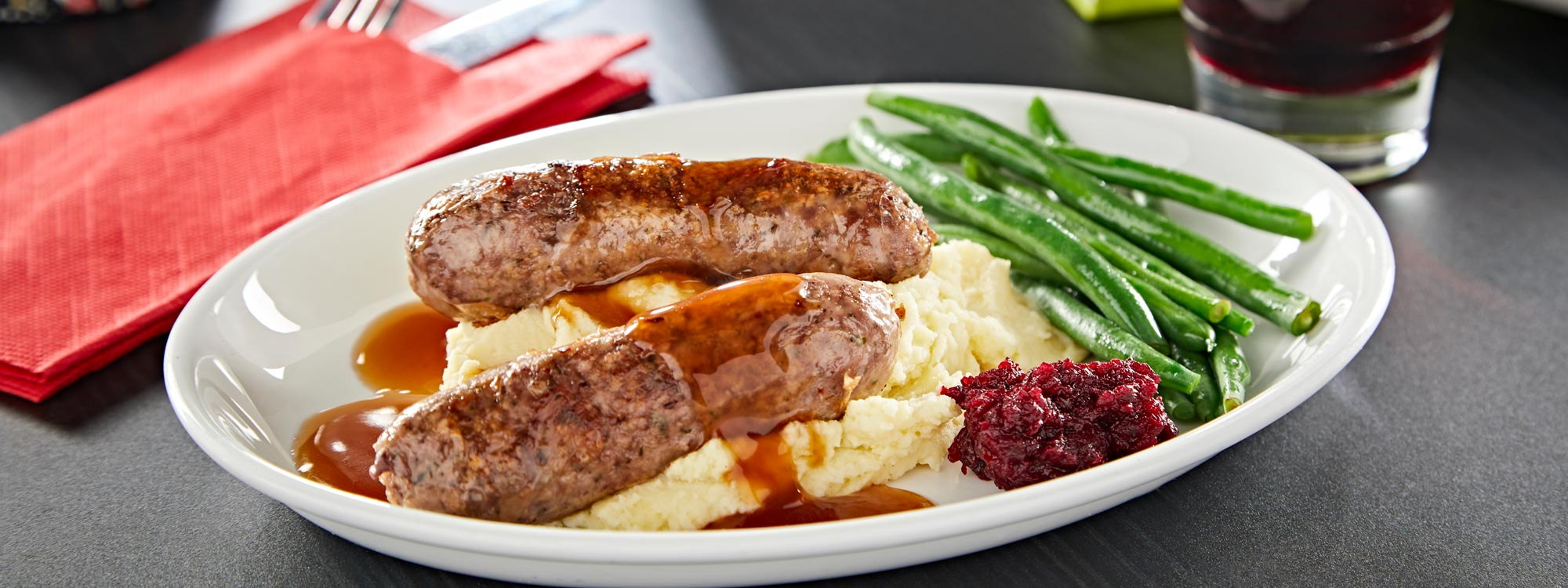 Venison sausages, mash and green beans LNER First Class Menu