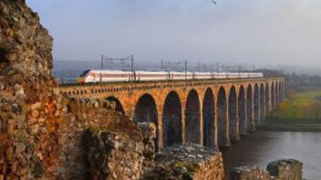 An LNER train travelling over a viaduct